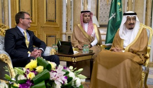 U.S. Defense Secretary Ash Carter meets with Saudi Arabia's King Salman bin Abdul Aziz (R) at Al-Salam Palace in Jeddah, Saudi Arabia, Wednesday, July 22, 2015. Carter flew into Saudi Arabia for meetings on Wednesday with King Salman and his security leadership to reassure the kingdom of America's support after Washington struck a nuclear deal with its arch-rival Iran. REUTERS/Carolyn Kaster/Pool - RTX1LBXR
