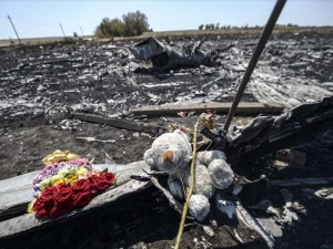 This photo taken on July 26, 2014 shows flowers and a teddy bear, left by parents of an Australian victim of the crash, laid on a piece of the Malaysia Airlines plane MH17, near the village of Hrabove (Grabovo), in the Donetsk region. Ukraine sought on July 25 to avoid a political crisis after the shock resignation of its prime minister, as fighting between the army and rebels close to the Malaysian airliner crash site claimed over a dozen more lives. Dutch and Australian forces were being readied on July 26 for possible deployment to secure the rebel-held crash site of the Malaysia Airlines flight MH17 in east Ukraine where many victims' remains still lie nine days after the disaster claimed 298 lives. AFP PHOTO/ BULENT KILICBULENT KILIC/AFP/Getty Images