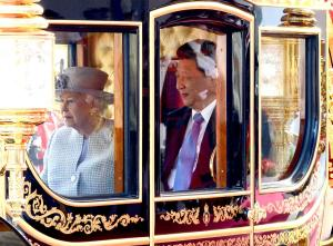 Britain's Queen Elizabeth II sits in a carriage with Chinese President Xi Jinping, right, as they travel through Horse Guards Parade, in London, Tuesday, Oct. 20, 2015, on the first official day of a state visit. Chinese President Xi Jinping prepared to address Britain's Parliament and dine with Queen Elizabeth II Tuesday as he began a state visit that is intended to cement close economic ties between the two countries — but risks being overshadowed by concerns over Beijing's growing economic clout in Britain. (Jeremy Selwyn, Pool Photo via AP)