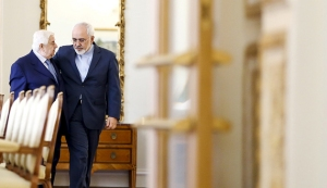 Iranian Foreign Minister Mohammad Javad Zarif (R) and his Syrian counterpart Walid al-Moualem walk before they start a meeting in Tehran August 5, 2015. Syrian Foreign Minister Walid al-Moualem arrived in Tehran on Tuesday for talks with officials from allies Iran and Russia that are expected to focus on efforts to end the civil war in his country. REUTERS/Raheb Homavandi/TIMA ATTENTION EDITORS - THIS PICTURE WAS PROVIDED BY A THIRD PARTY. REUTERS IS UNABLE TO INDEPENDENTLY VERIFY THE AUTHENTICITY, CONTENT, LOCATION OR DATE OF THIS IMAGE. FOR EDITORIAL USE ONLY. NOT FOR SALE FOR MARKETING OR ADVERTISING CAMPAIGNS. NO THIRD PARTY SALES. NOT FOR USE BY REUTERS THIRD PARTY DISTRIBUTORS. THIS PICTURE IS DISTRIBUTED EXACTLY AS RECEIVED BY REUTERS, AS A SERVICE TO CLIENTS - RTX1N408